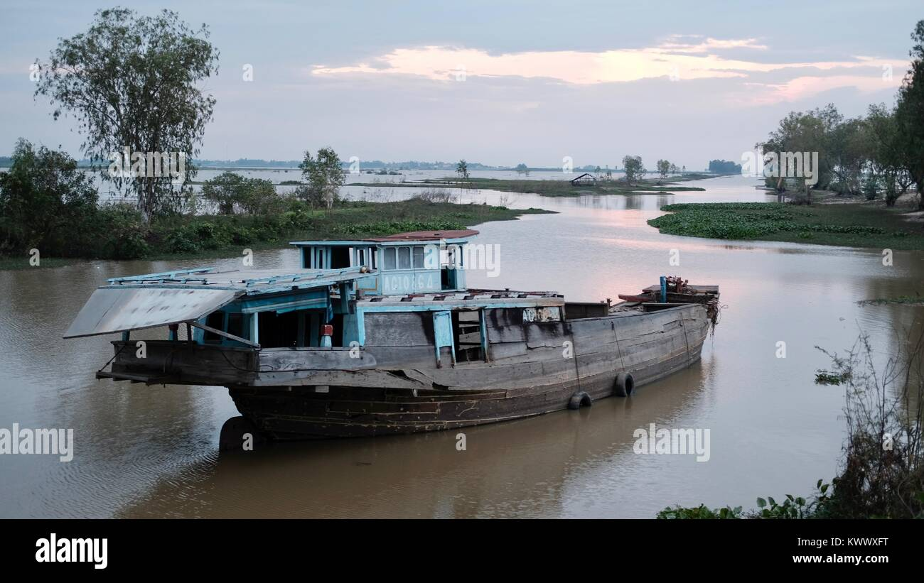 Abandoned Boat on the Borei Shoreline Takeo, Cambodia Decrepit Third World Underdeveloped Country South East Asia - Stock Image