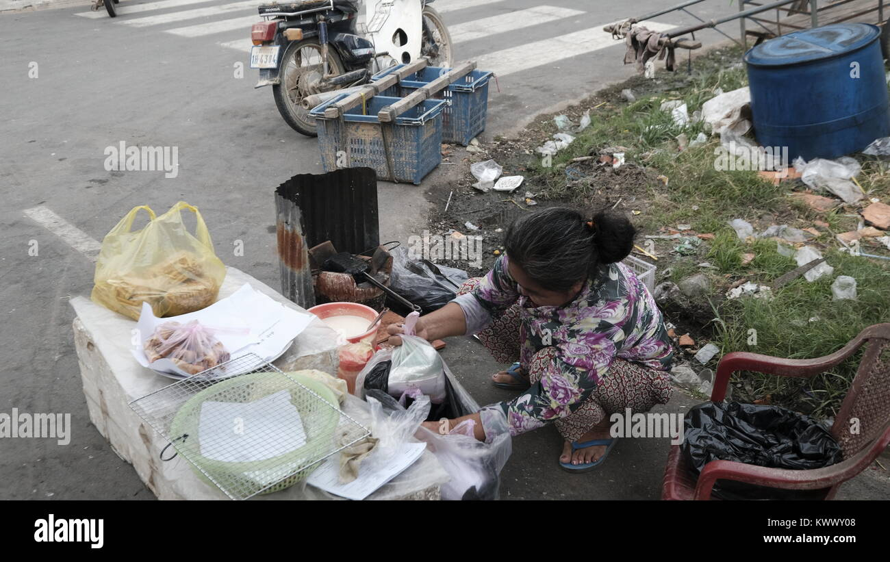 Lady Street vendor in Former Khmer Rouge Stronghold Takeo, Cambodia Decrepit Third World Underdeveloped Country - Stock Image