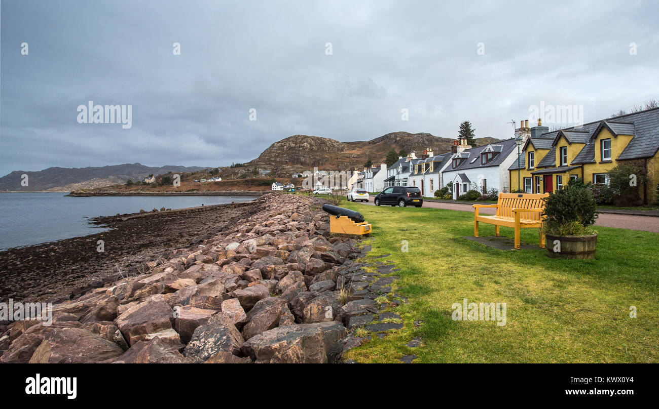 The remote village of Shieldaig wraps itself along the shoreline of Loch Shieldaig in the Torridon area of the Scottish - Stock Image