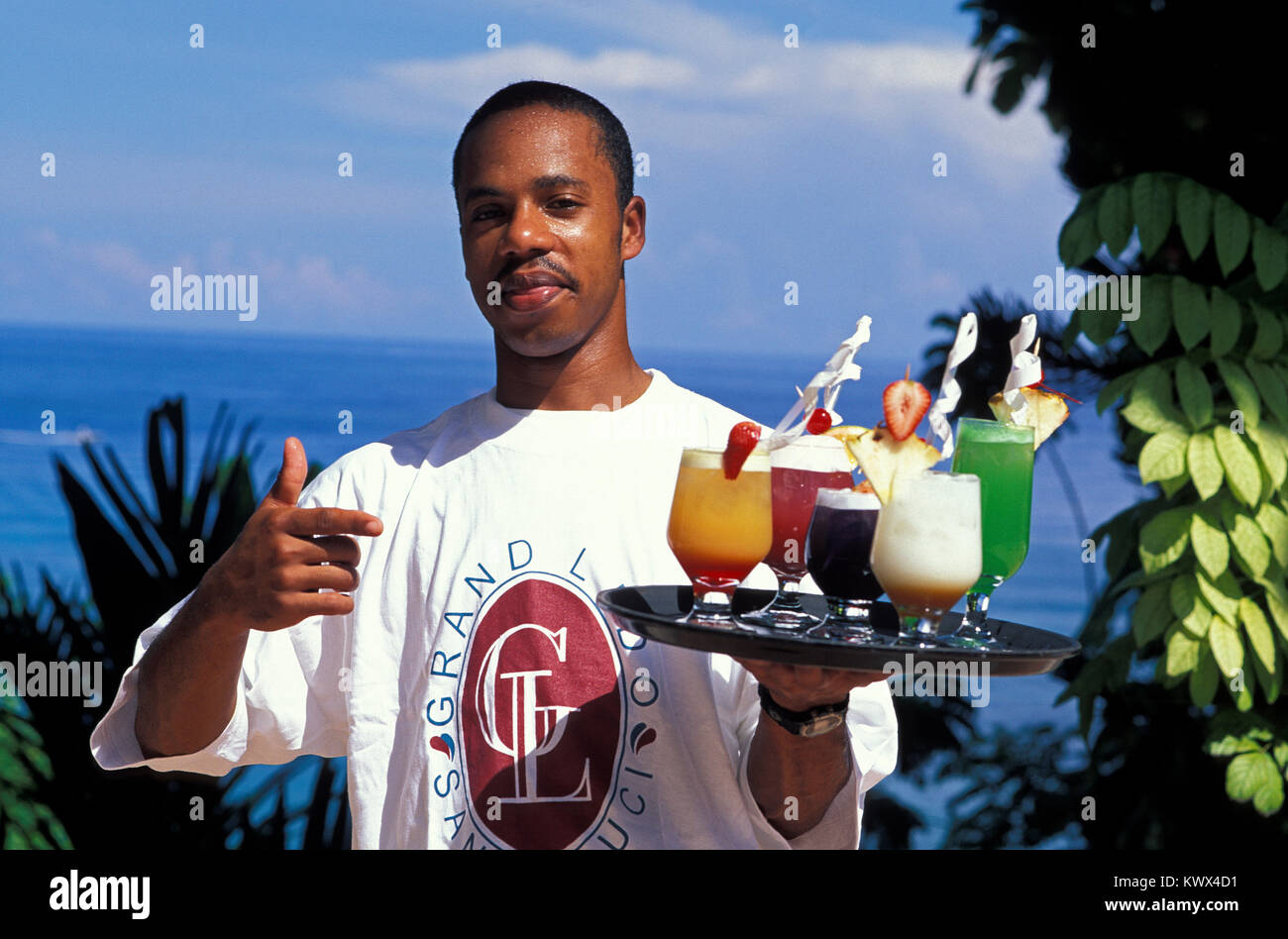 Barkeeper with Coktails, Jamaica - Stock Image