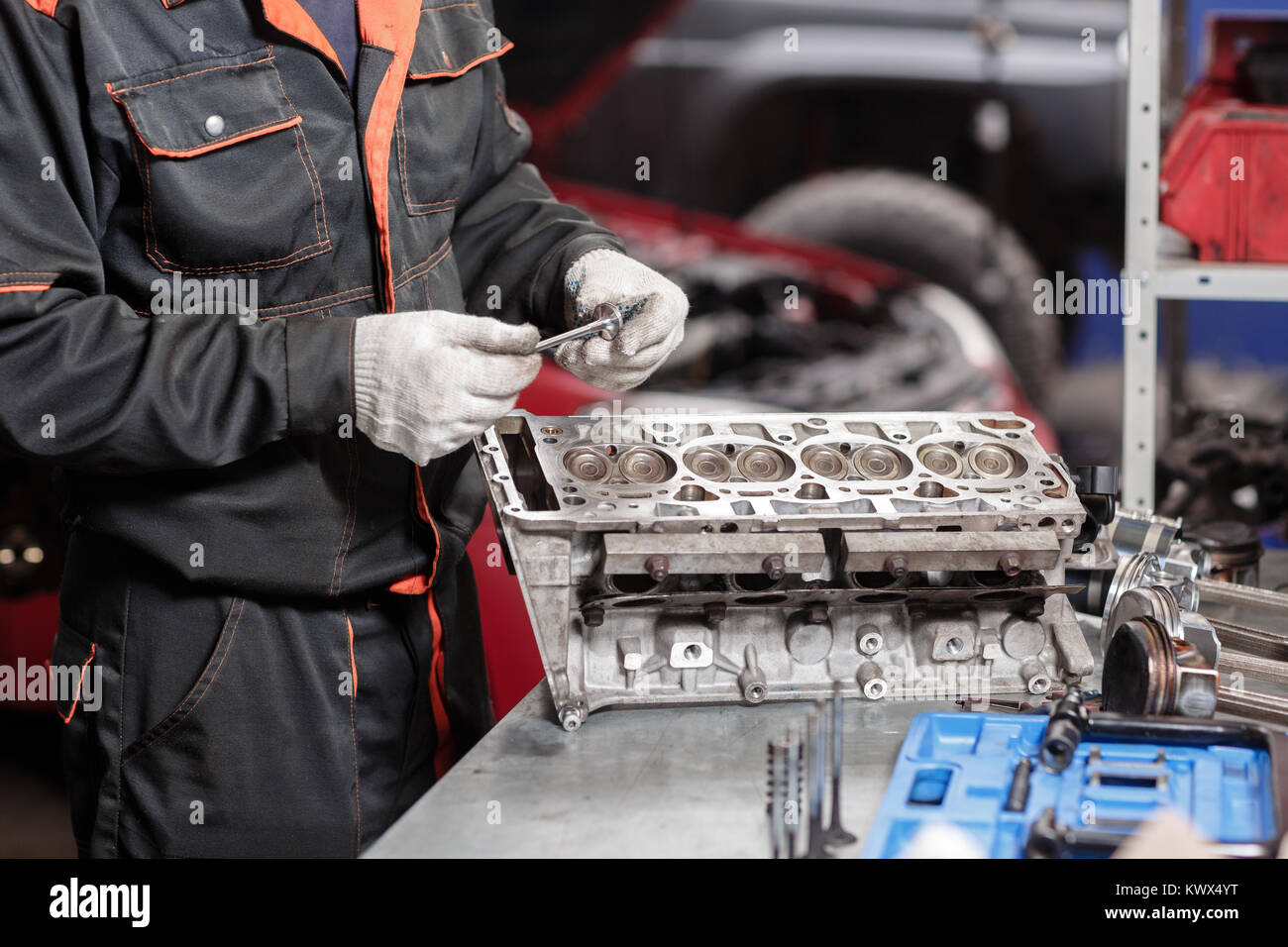 Selective focus. Engine Block on a repair stand with Piston and Connecting Rod of Automotive technology. Blurred - Stock Image