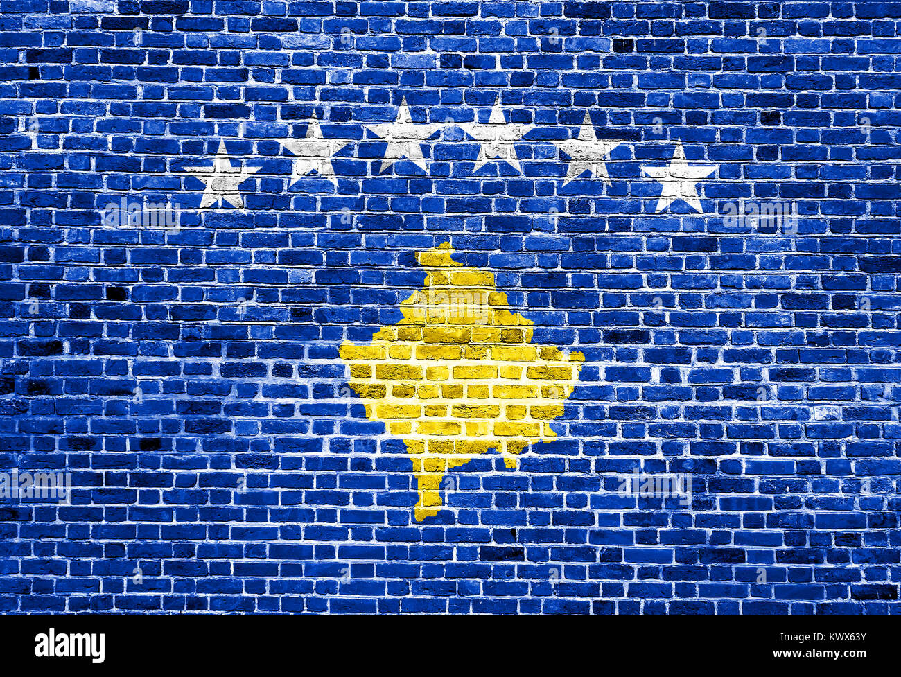Flag of Kosovo painted on brick wall, background texture Stock Photo