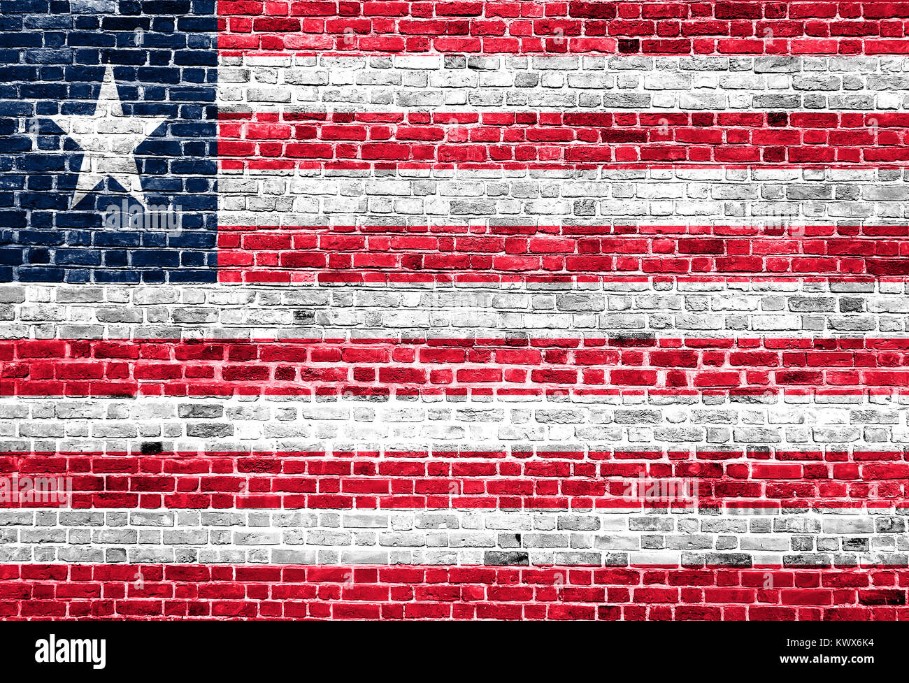 Flag of Liberia painted on brick wall, background texture - Stock Image