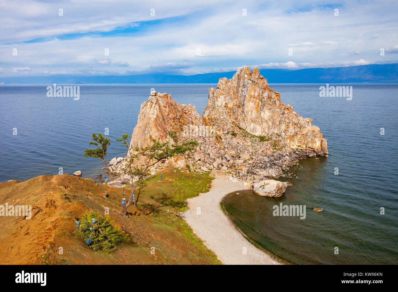 Shamanka (Shamans Rock) on Baikal lake near Khuzhir at Olkhon island in Siberia, Russia. Lake Baikal is the largest - Stock Image