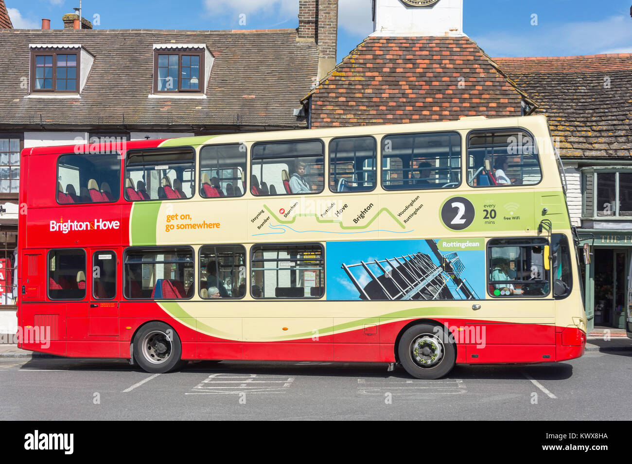Local double-decker bus at bus stop, High Street, Steyning, West Sussex, England, United Kingdom - Stock Image