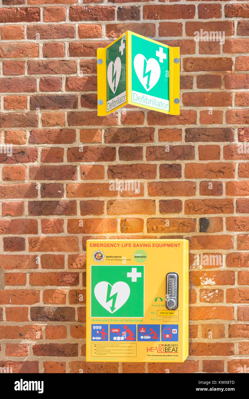 Automated External Defibrillator on wall of The Market House, Market Square, Potton, Bedfordshire, England, United - Stock Image
