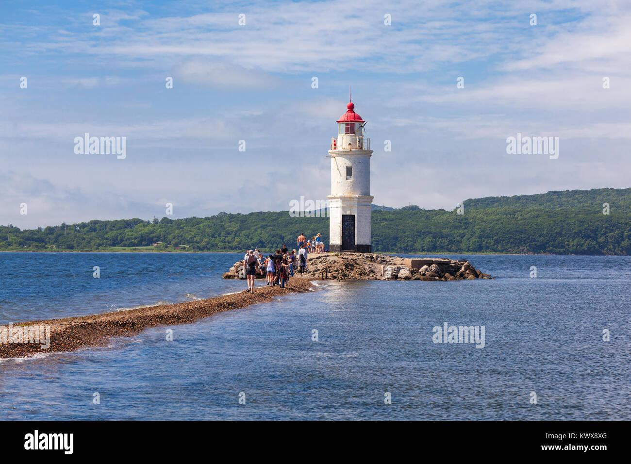 Lighthouse Tokarevskiy Egersheld on Tokarevskaya Koshka cape in Vladivostok, Primorsky Krai in Russia - Stock Image