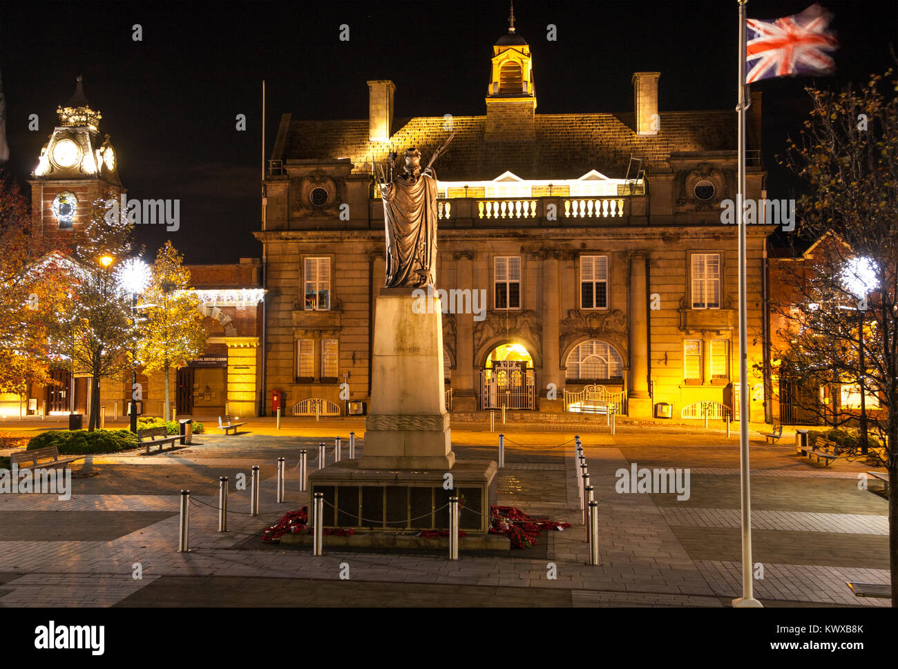 Crewe town center Cheshire floodlit at Christmas time with Christmas tree and lights showing the war memorial municipal - Stock Image