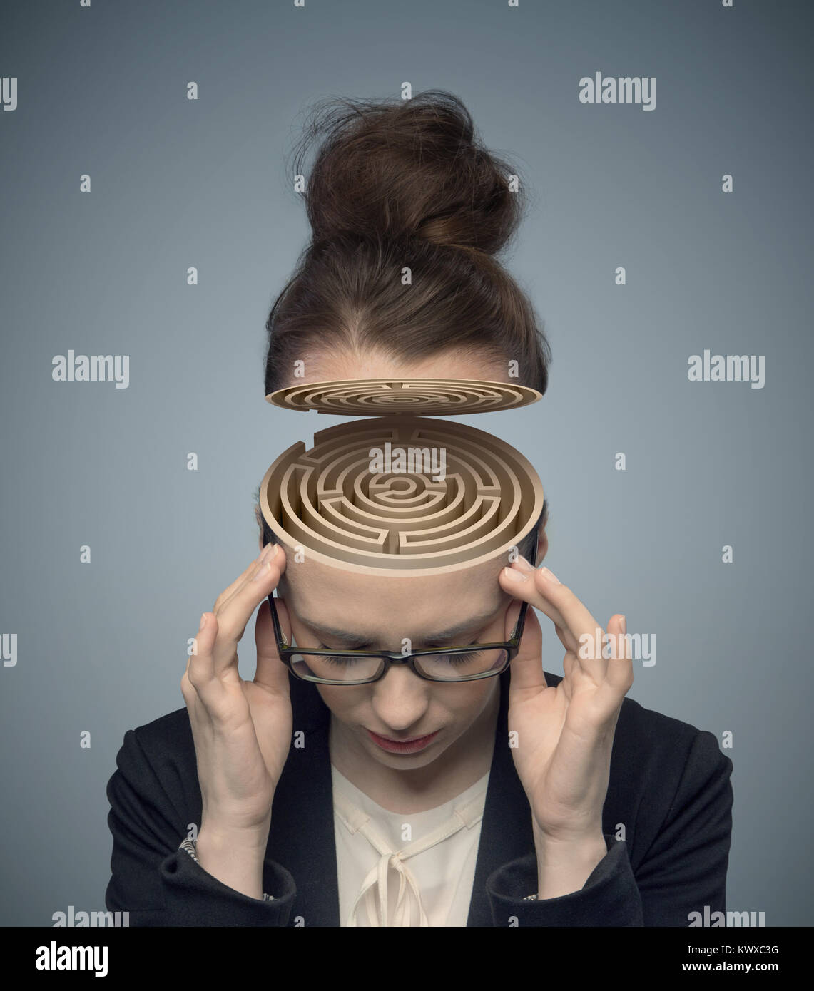 Conceptual image of a labyrinth in the woman's brain - Stock Image