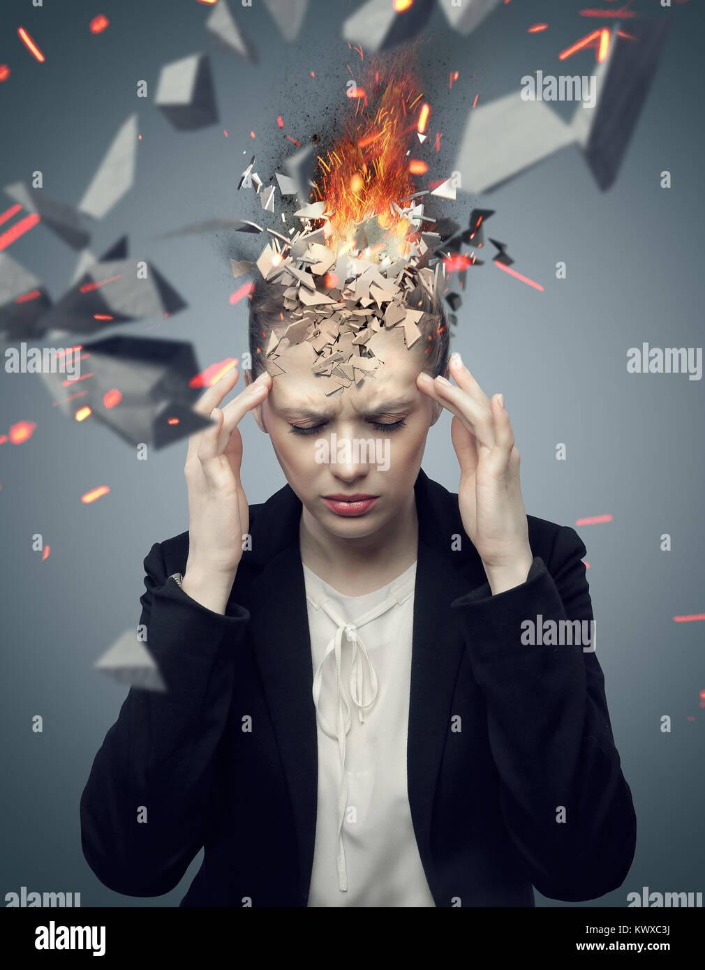 Smart businesswoman with exploding headache Stock Photo