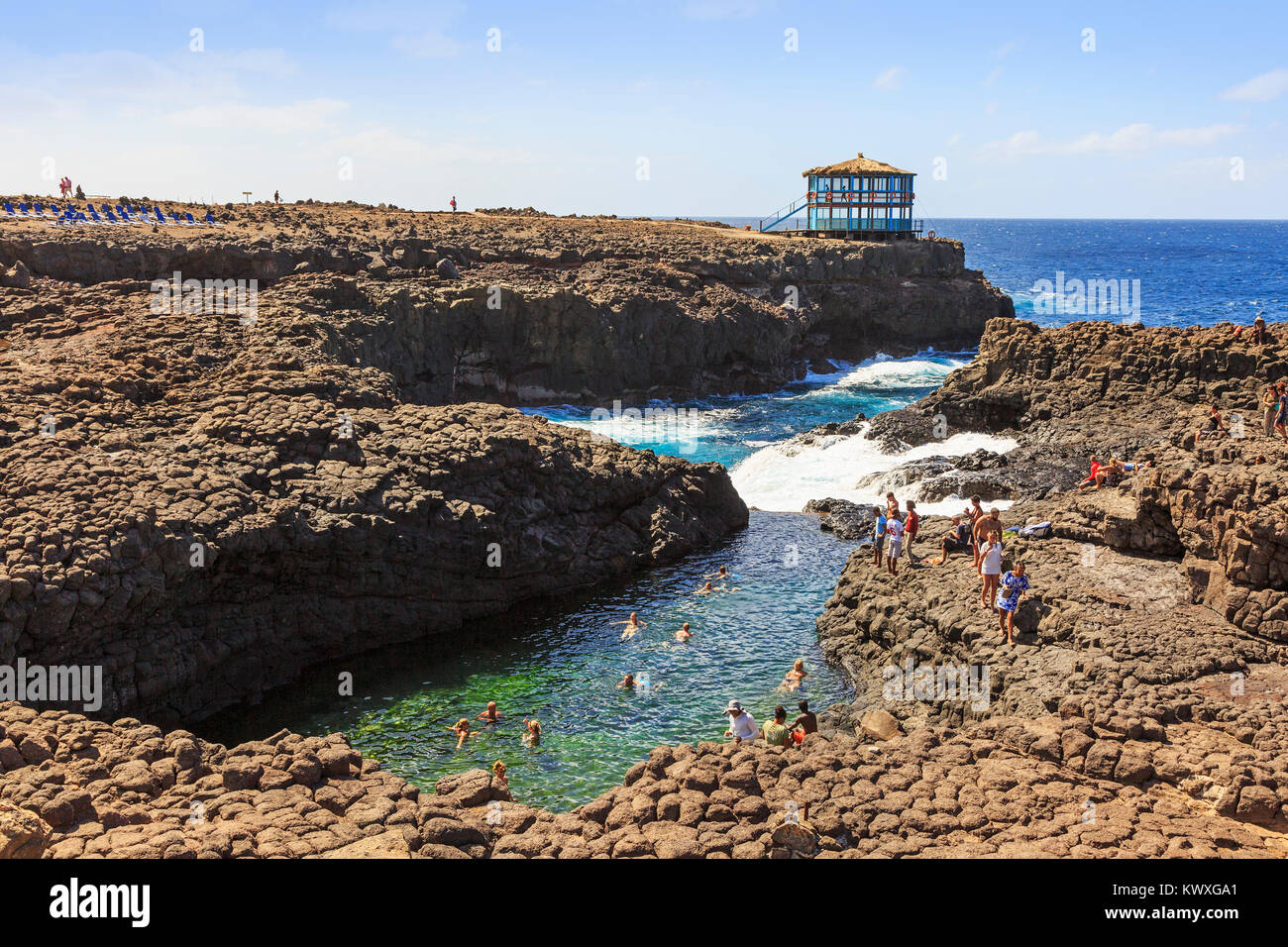 NAtural swimming pool formed in the rocks ar Baracona, on the west coast of Sal Island, Salinas, Cape Verde near - Stock Image