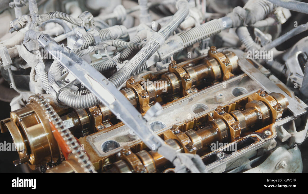 The internal combustion engine, disassembled, repair at car service, overhaul, under the hood of the car Stock Photo