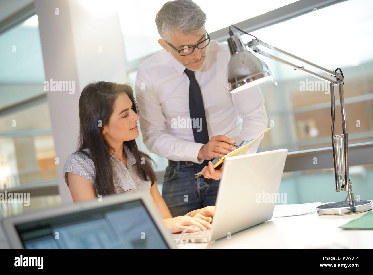 Businessman giving instructions to associate - Stock Image
