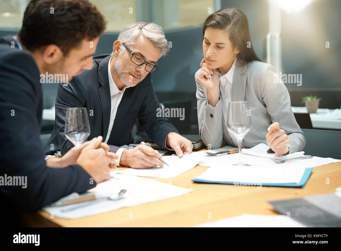 Executive people doing business report presentation in restaurant - Stock Image