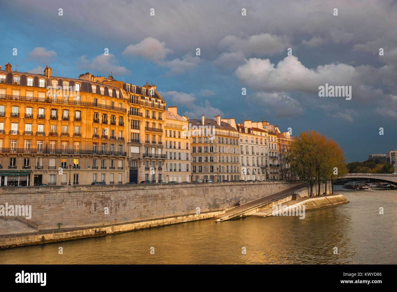 Paris quai Seine, view at sunset across the River Seine of apartments along the Quai d'Orleans on the Ile St - Stock Image