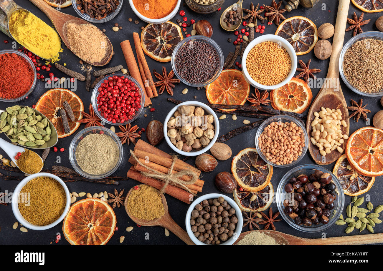 Composition of various spices on a black background - Stock Image
