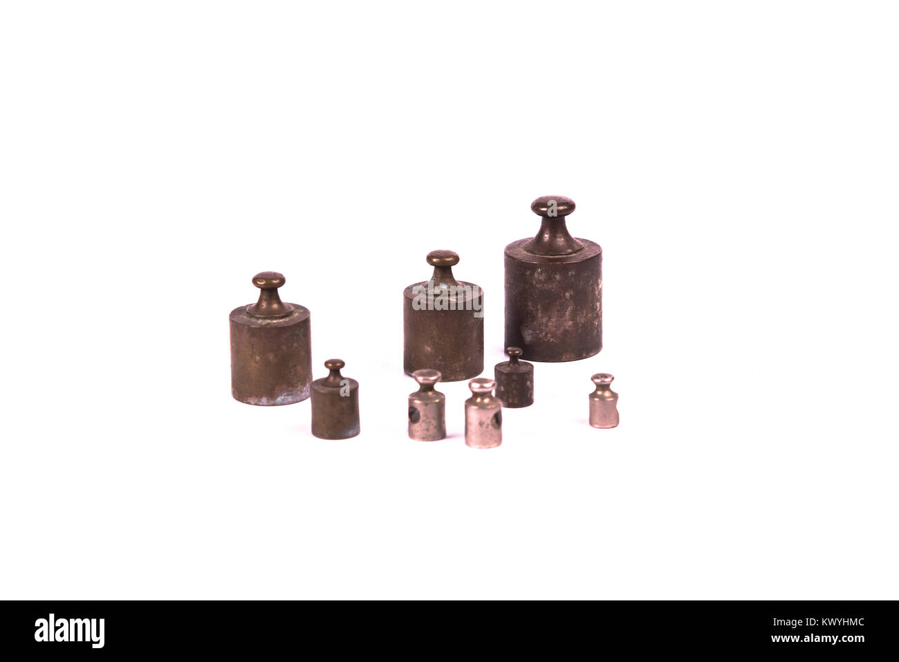 vintage weights over a white background - Stock Image