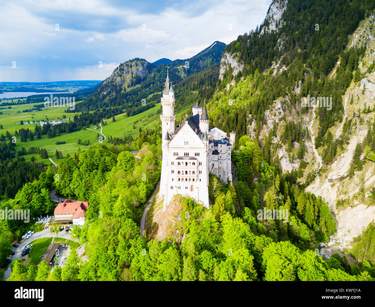 Schloss Neuschwanstein or New Swanstone Castle aerial panoramic view. Neuschwanstein Castle is a Romanesque Revival - Stock Image