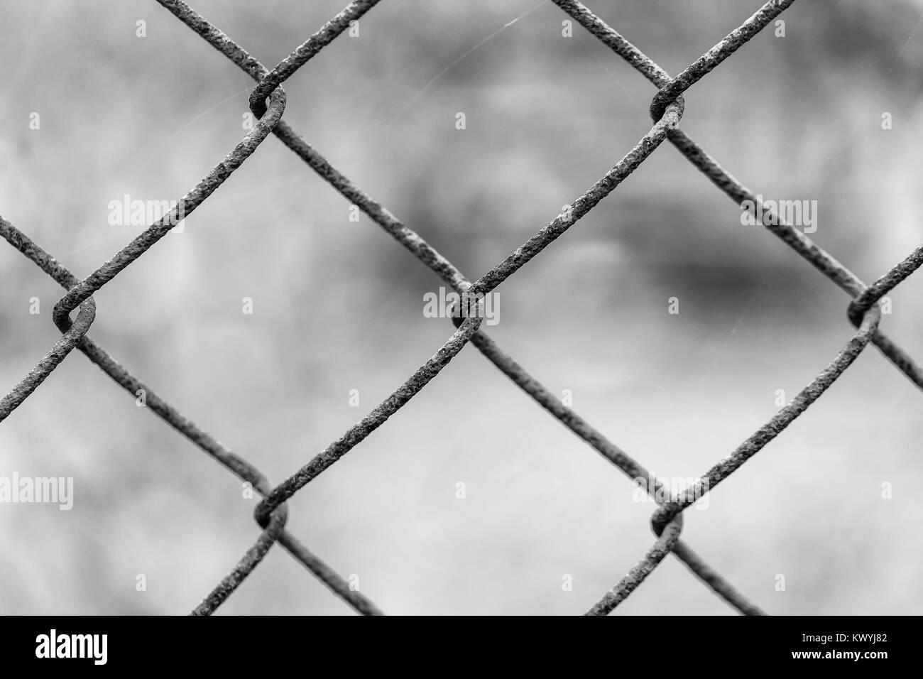 Beautiful netting mesh pattern on a blurred background. Rust. - Stock Image