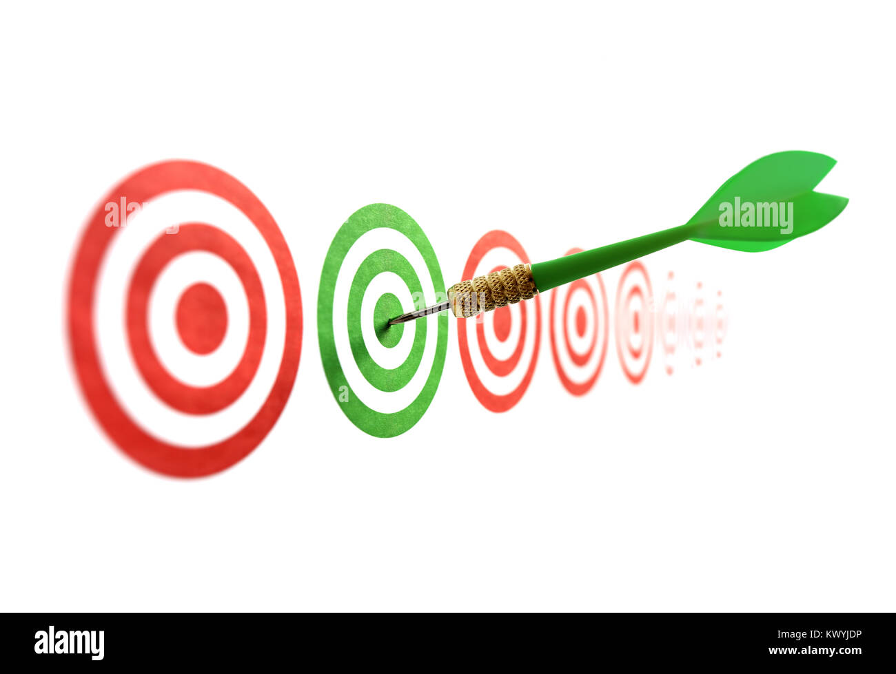 Green dart in target concept for accuracy, accomplishment and business success - Stock Image