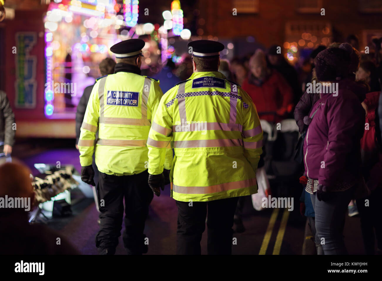 Police in hi-visibility jackets policing crowd control at a UK event - Stock Image
