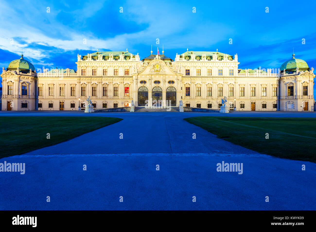 The Belvedere Palace is a historic building complex in Vienna, Austria at sunset. Belvedere was built as a summer - Stock Image