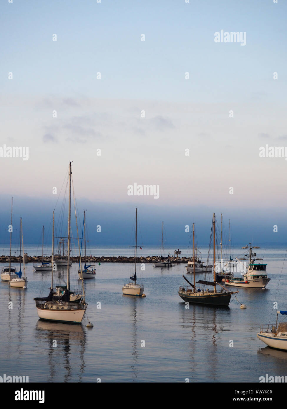 Monterey, CA - 11 August 2016: Yachts ares anchored at the harbor of the Californian port city of Monterey. - Stock Image