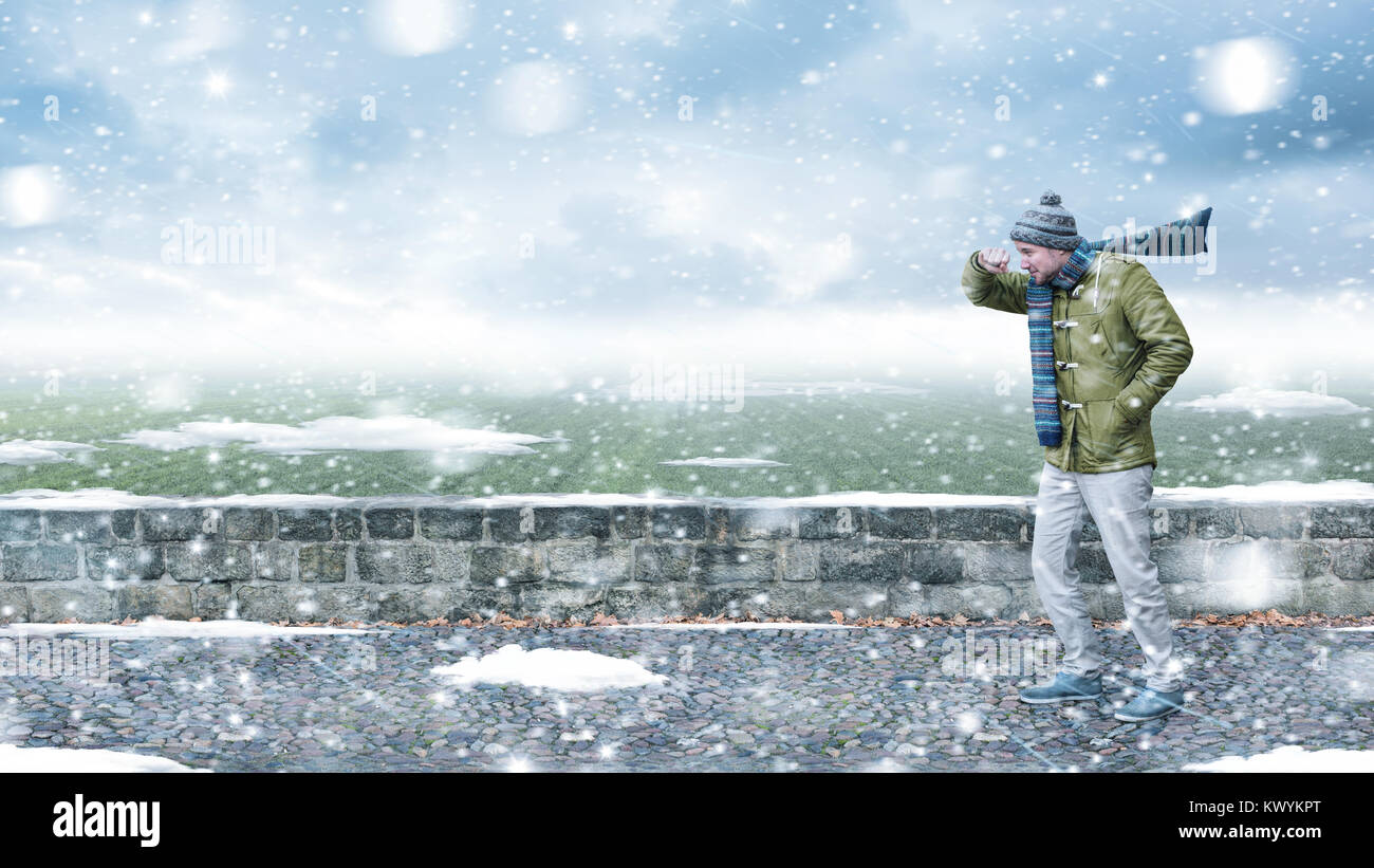Pedestrian in a snowstorm - Stock Image