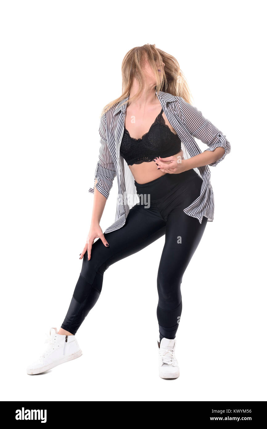 Young blonde female dancer swinging flowing blonde hair while jazz dancing. Full body length portrait isolated on - Stock Image