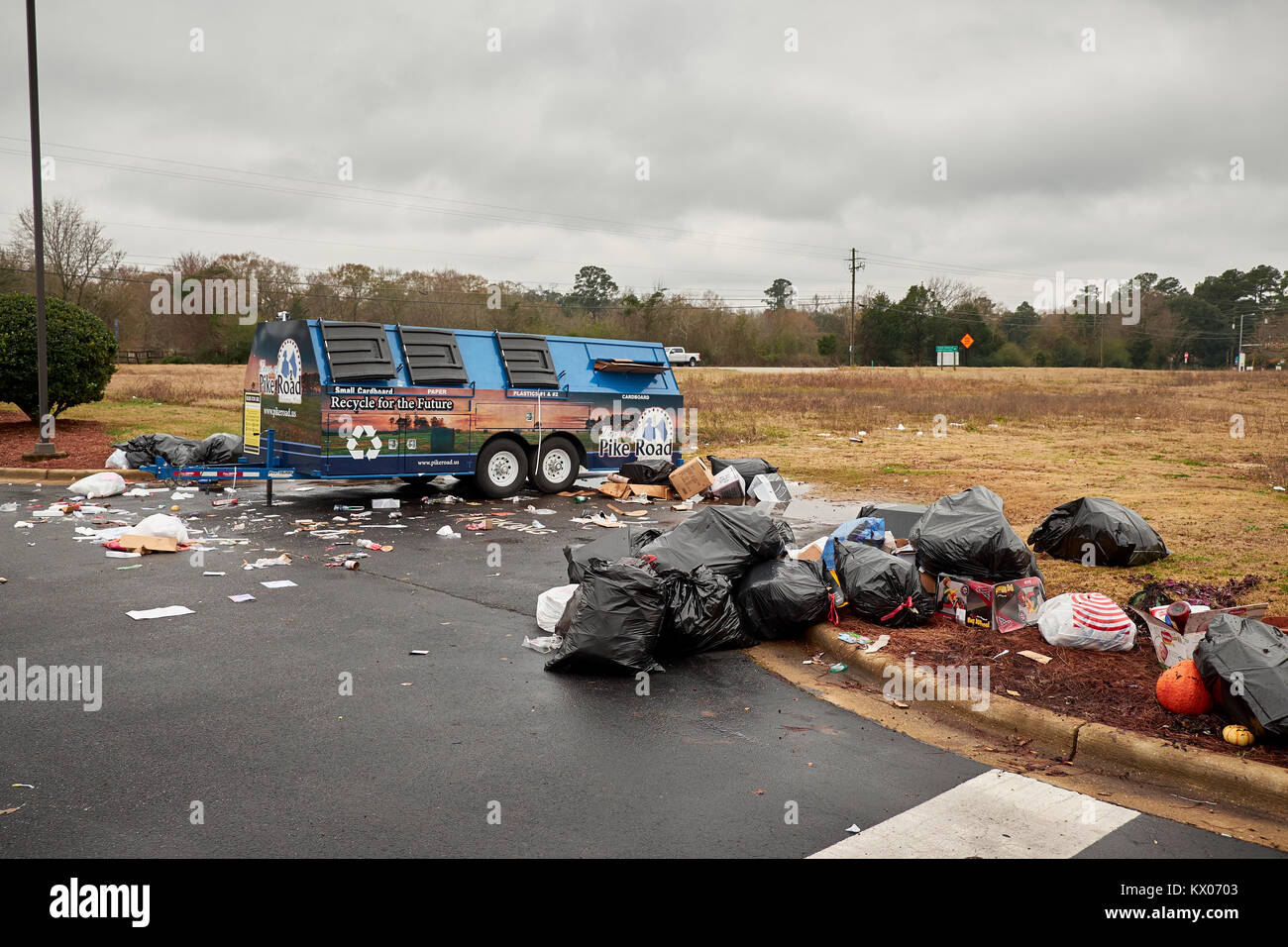 Overflow mess of uncollected plastic, cardboard and paper at recycle or recycling bin waiting for pick up in Pike - Stock Image