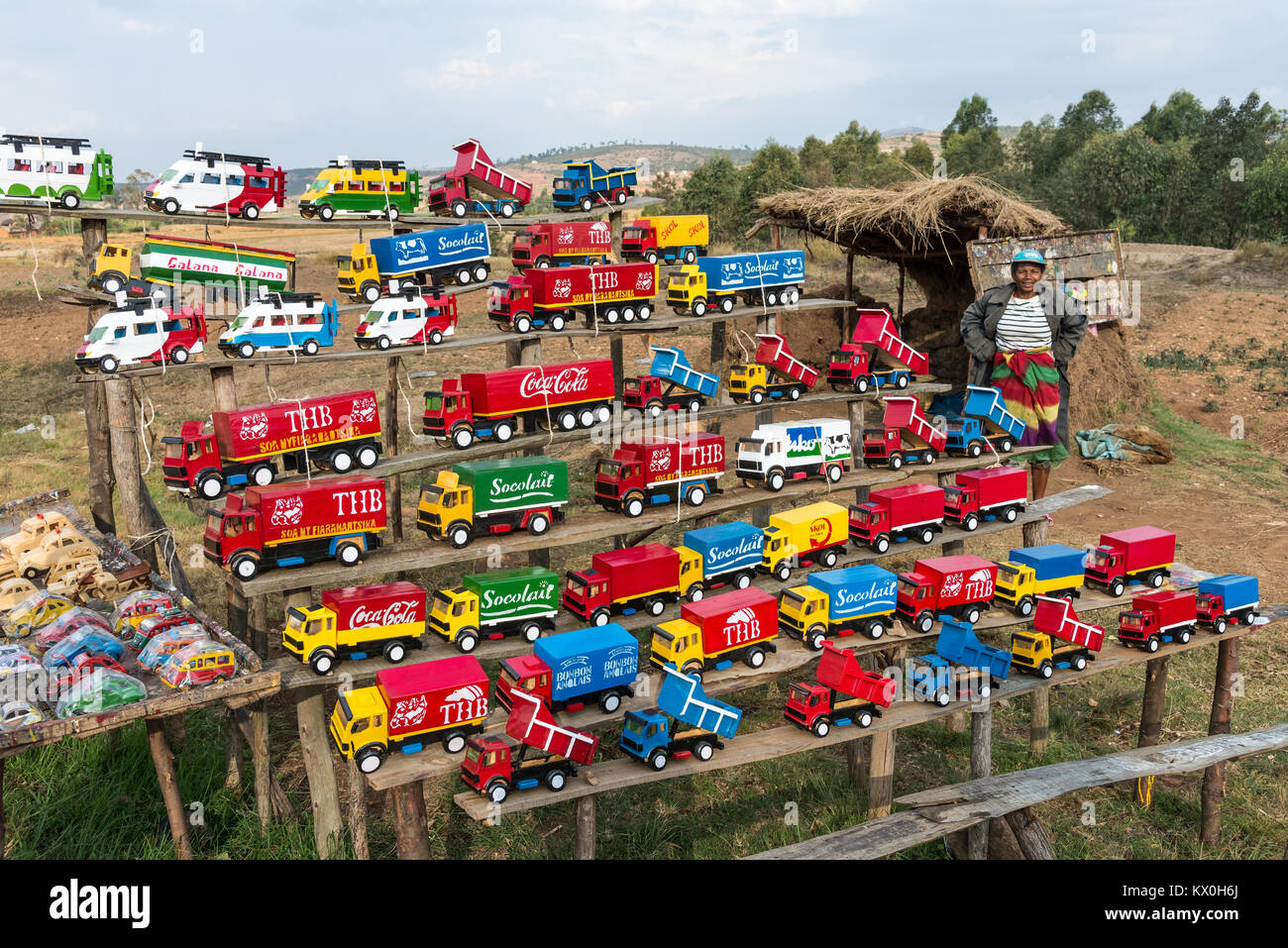 toy cars and trucks. Colorful Toy Cars And Trucks Are For Sell On Road Side Stand. Madagascar, Africa.