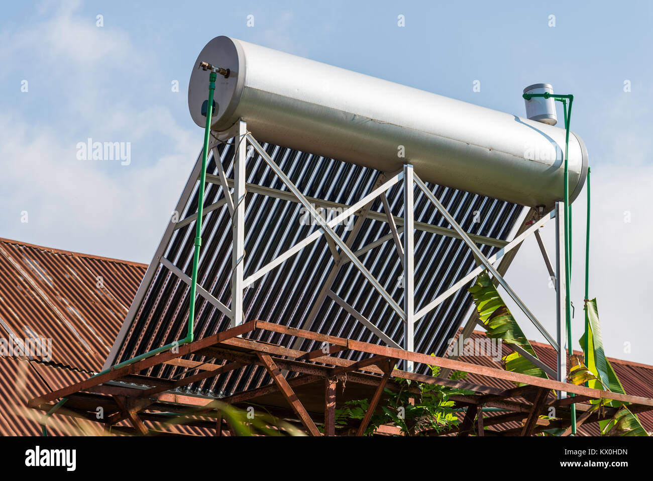 A roof-top solar powered water heater. Madagascar, Africa. - Stock Image