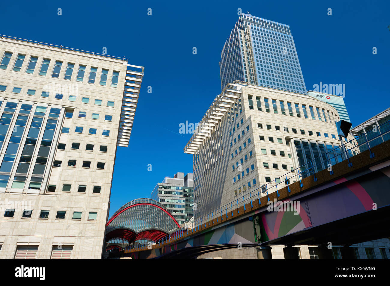 LONDON, ENGLAND - MAY 5, 2013: Canary Wharf, DLR station with several bank buildings as a backdrop. - Stock Image
