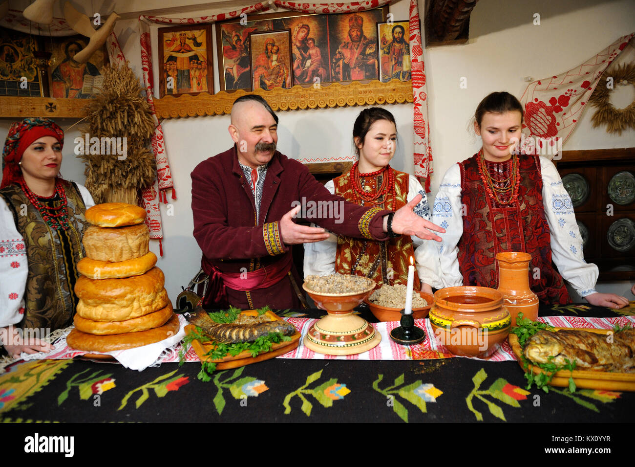 Christmas Eve Dresses.People In Ukrainian Native Dresses Standing Behind Table To