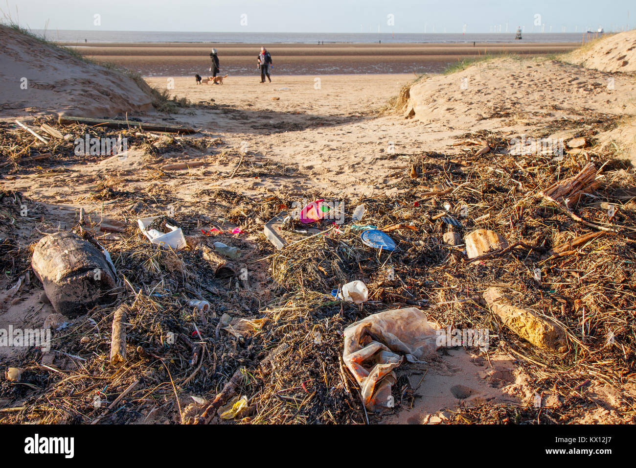 Crosby beach, Liverpool, Merseyside UK. Dumped drinks cups, plastic cutlery, straws, plastic bottles, lids stirrers, - Stock Image