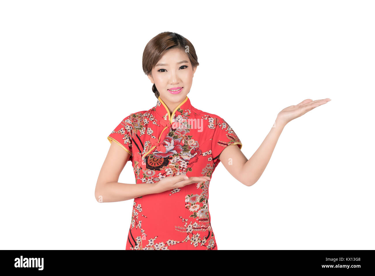 61d898fb6 Pretty Asian female with Chinese traditional dress cheongsam or qipao hand  showing blank space. Chinese