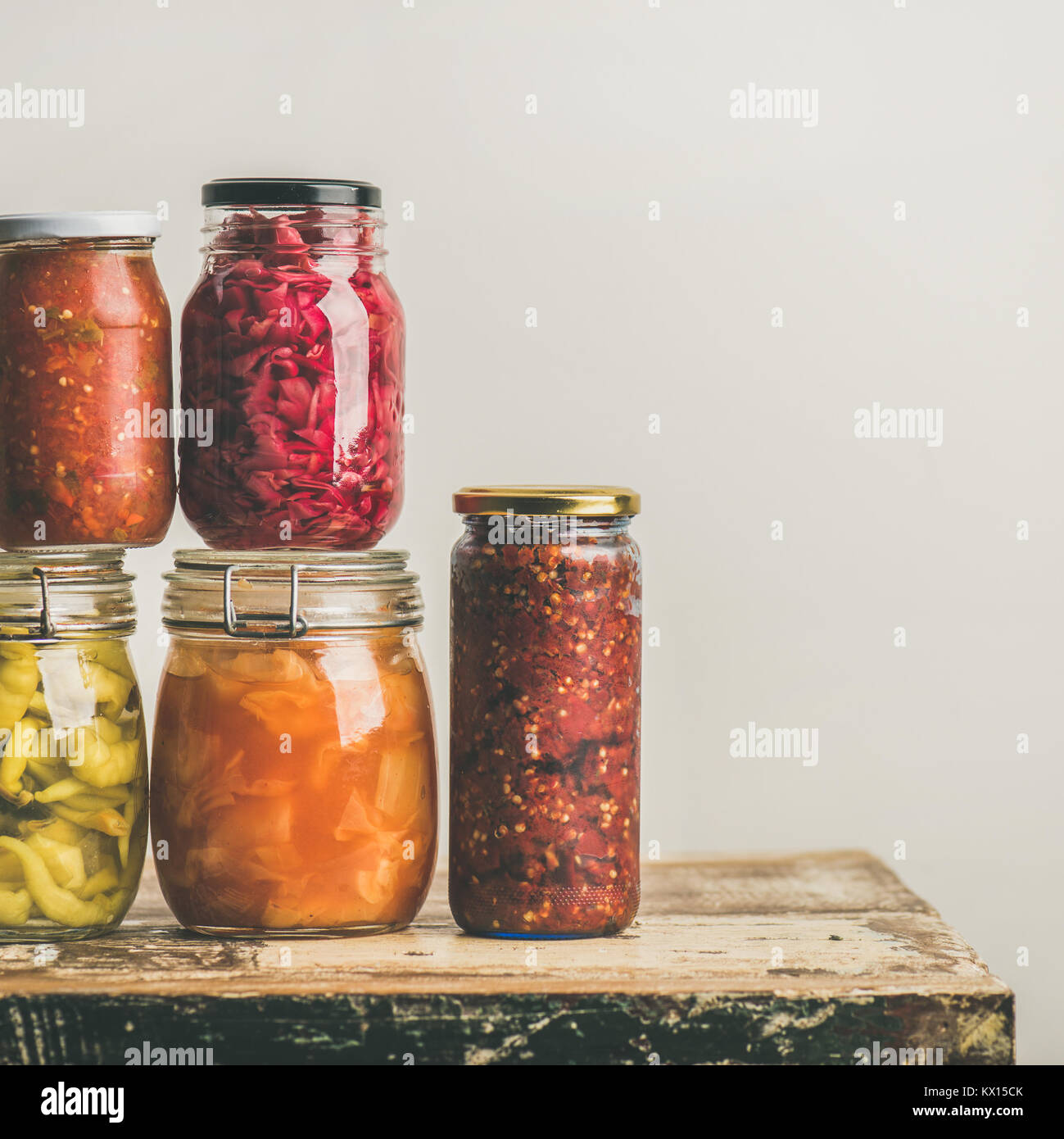 Autumn seasonal pickled or fermented vegetables in jars. Home canning - Stock Image