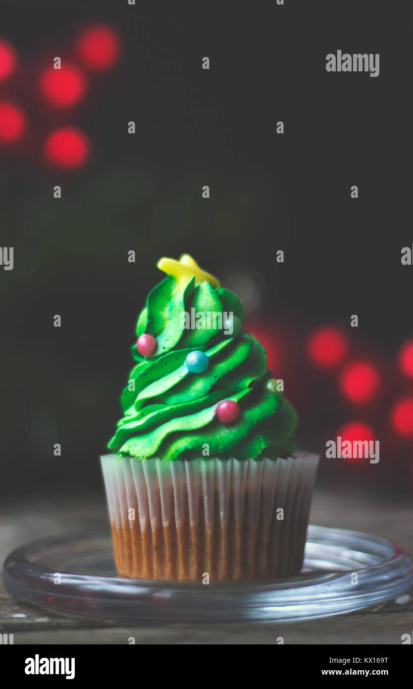 Homemade cupcake decorated as christmas tree; christmas or new year background with copy space - Stock Image