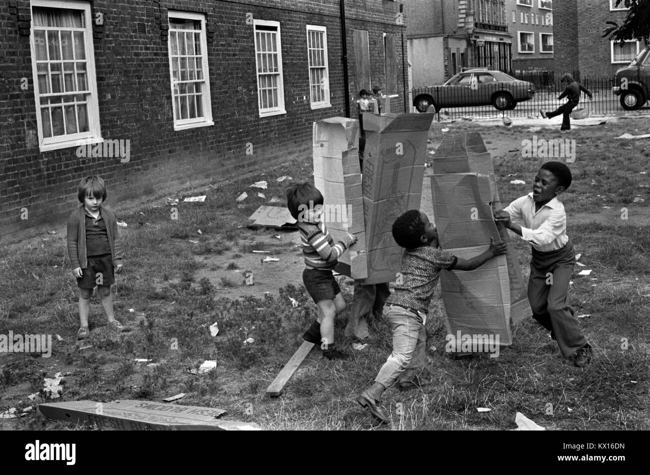 Preteen group of boys playing  together on their council estate South London 1970s Britain  70s UK HOMER SYKES Stock Photo