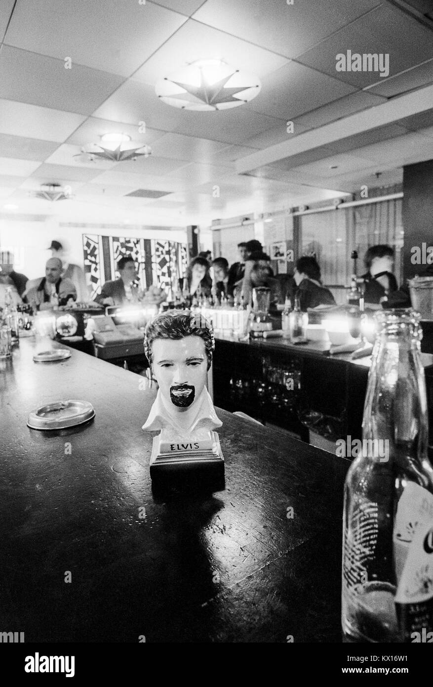 Elvis bust with goatee beard on the bar in a club in London, 1980s. - Stock Image