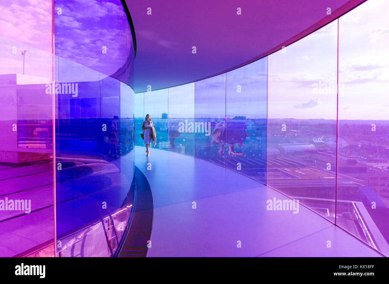 Visitors enjoy Your Rainbow panorama of Aarhus at Aros Art Museum. The museum is the second most visited in Denmark. - Stock Image