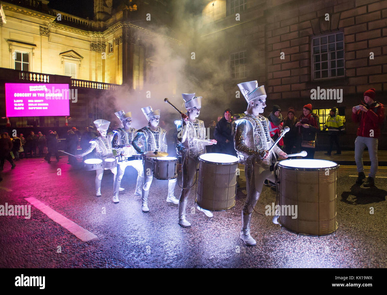 Spark LED Drummers entertain crowds on the Mound as part of the Edinburgh Hogmanay Celebrations 2017/18. - Stock Image