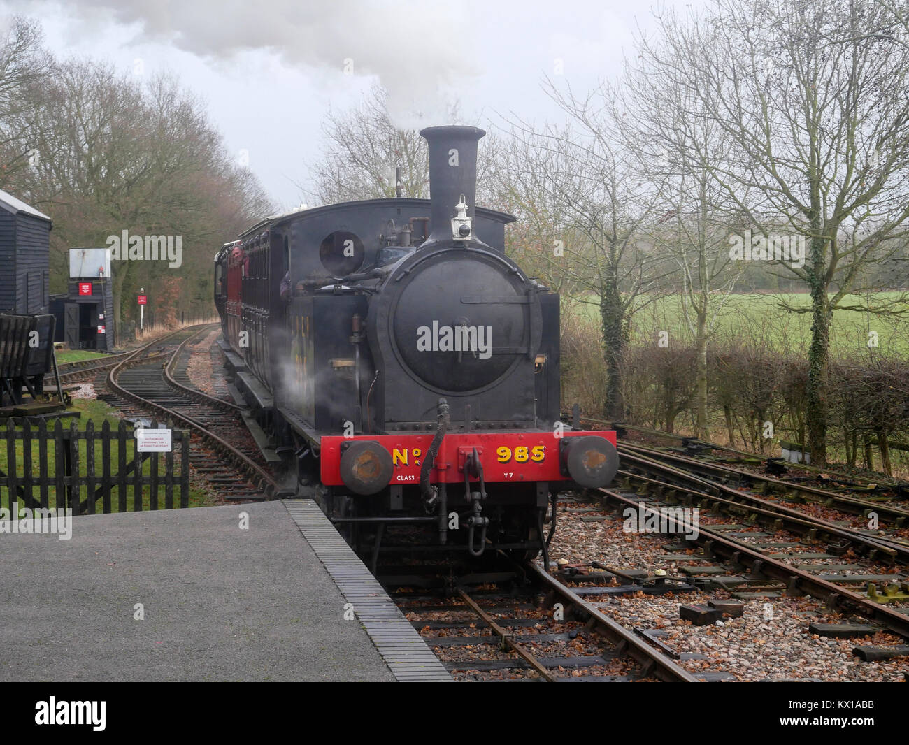 An ex. London and North Eastern railway class Y7 0-4-0 tank engine brings a train into Brockford station - Stock Image