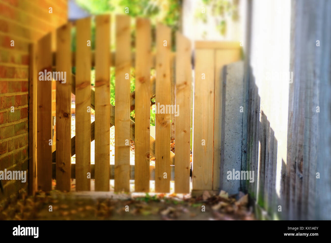 Wooden Picket Type Gate Fence Along A Side Wall Of A House