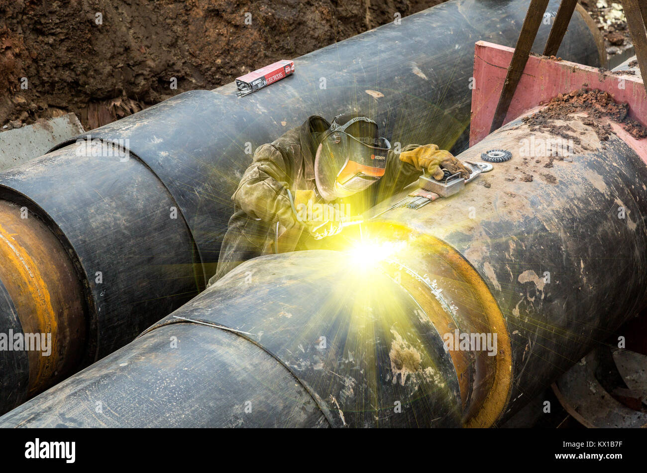 Samara, Russia - October 1, 2017: Worker with protective mask welding metal with sparks and smoke Stock Photo