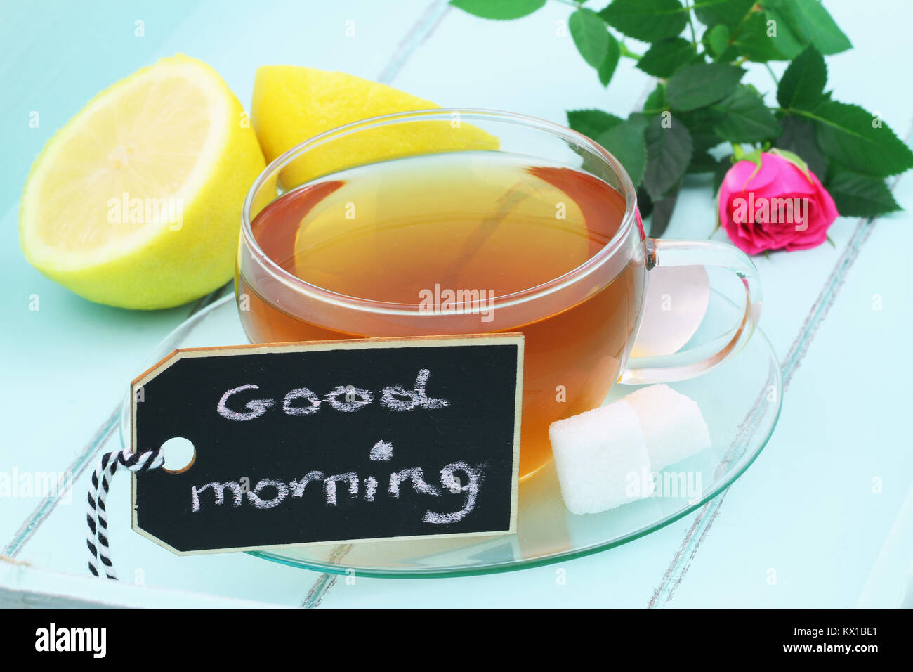 Good Morning Card With Cup Of Black Tea And Pink Rose On Green Wood