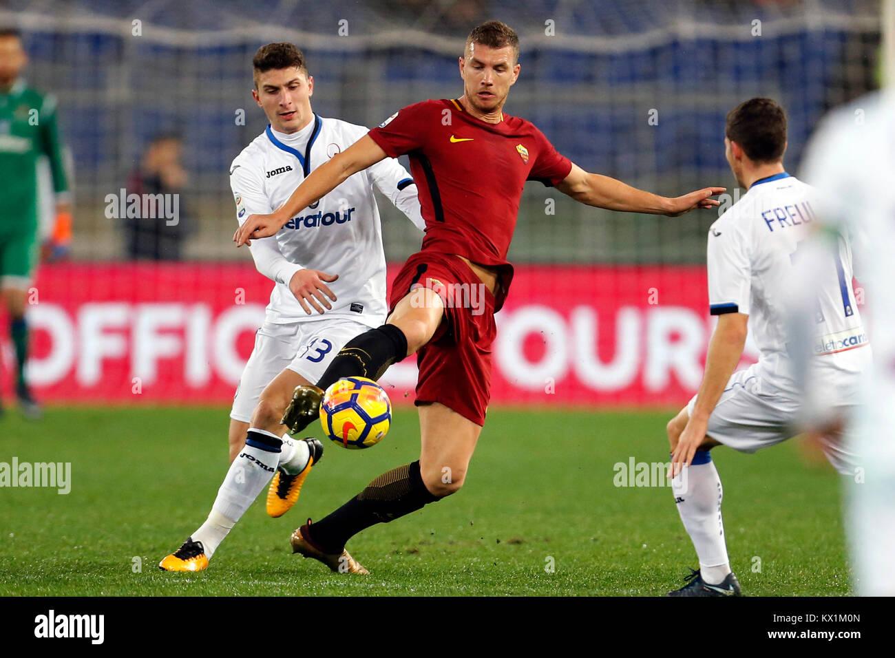 Olympic Stadium, ROME, Italy - 06/01/2018  (L-R) Mattia Caldara of Atalanta and Edin Dzeko of Roma fight for the - Stock Image