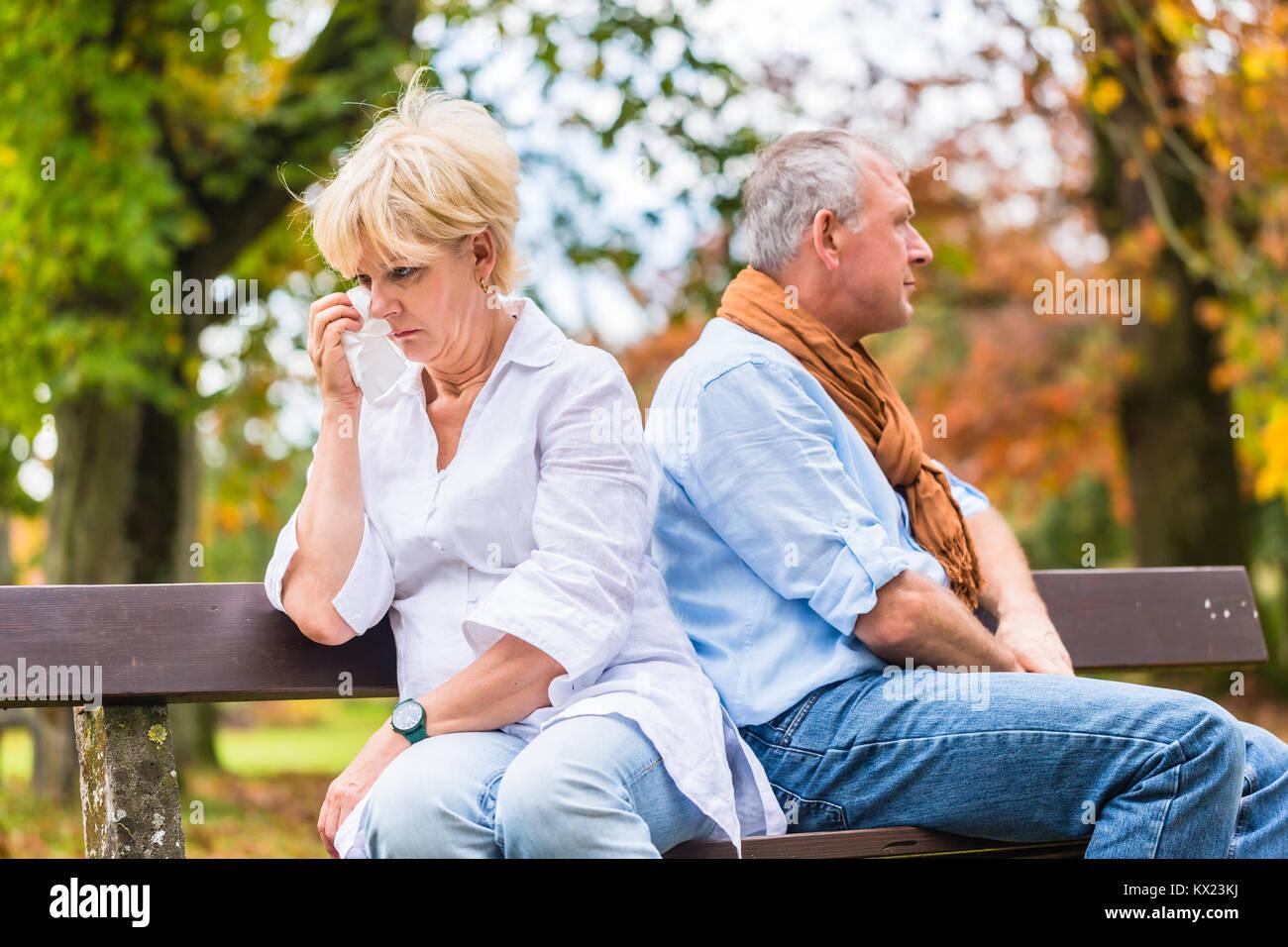 Senior man and woman having argument - Stock Image