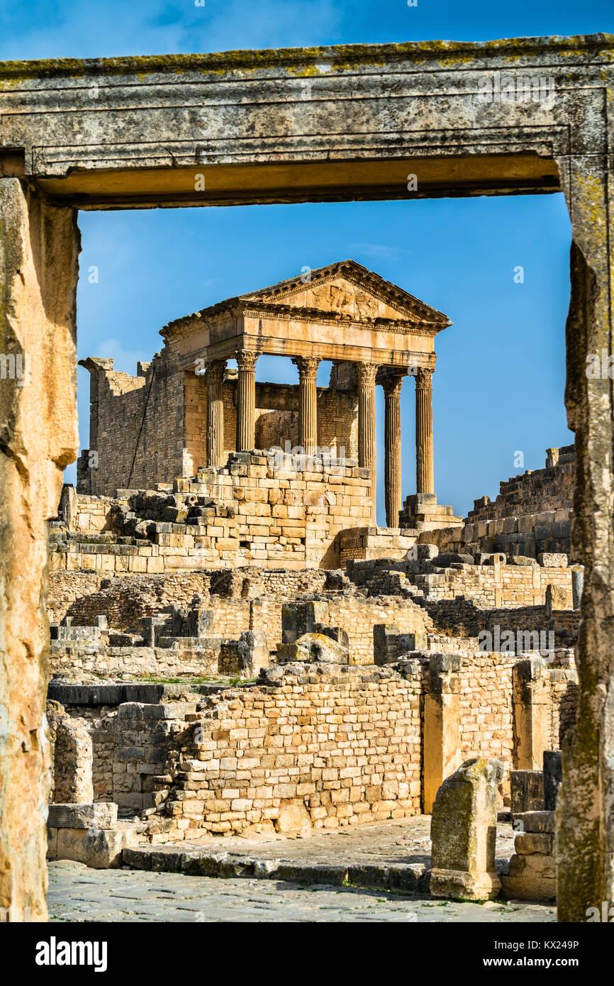 The Roman Capitol at Dougga. UNESCO heritage site in Tunisia - Stock Image