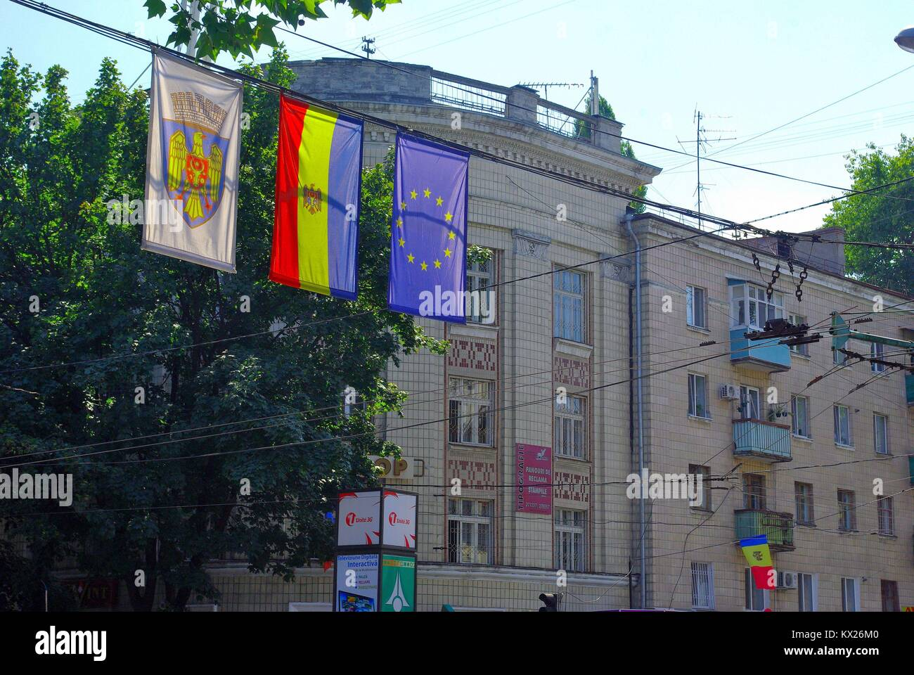At the Bulevard Stefan cel Mare in Chișinău (Republic of Moldova): Flags of the capital, Moldova and EU Stock Photo